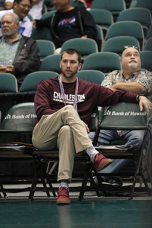 Charleston head coach Mike Iandolo watches the court in an opening night match against Hawaii at the Stan Sheriff Center in Honolulu, Hawaii on January 3, 2020.