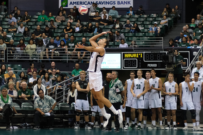 Hawaii middle Guilherme Voss (12) hits a jump float in the third set of an opening night match against Charleston at the Stan Sheriff Center in Honolulu, Hawaii on January 3, 2020.