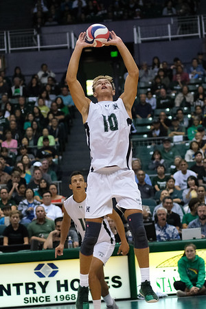 Hawaii setter Jakob Thelle (10) puts up a jump set as oppo Rado Parapunov (19) gets into his approach in an opening night match against Charleston at the Stan Sheriff Center in Honolulu, Hawaii on January 3, 2020.