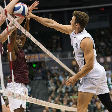 Hawaii outside Colton Cowell (17) pushes the ball off the Charleston block in an opening night match at the Stan Sheriff Center in Honolulu, Hawaii on January 3, 2020. Cowell led all players with 10.5 points.