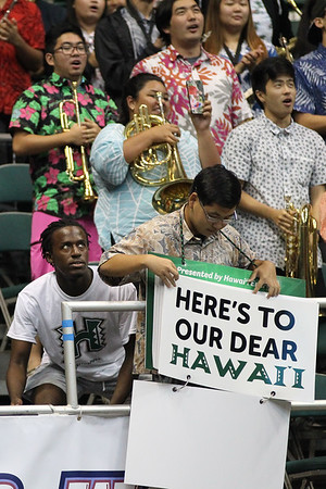 A University of Hawaii band member flips the lyrics to the Hawaii fight song as a fan tries to get on camera at an opening night volleyball match between Hawaii and Charleston at the Stan Sheriff Center in Honolulu, Hawaii on January 3, 2020.