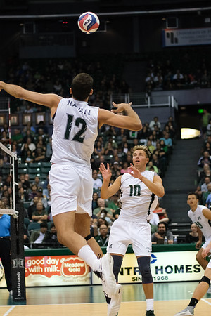 Hawaii middle blocker Guilherme Voss (12) prepares to hit a quick set from Jakob Thelle (10) in an opening night match against Charleston at the Stan Sheriff Center in Honolulu, Hawaii on January 3, 2020. Voss, a 6-7 freshman from Rio De Janeiro, Brazil, had 3 kills on 5 attempts.