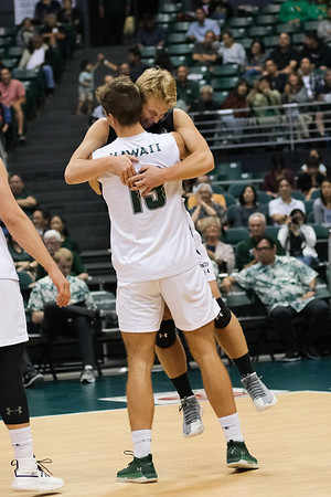 Hawaii libero Gage Worsley is embraced by middle blocker Max Rosenfeld (13) in an opening night match against Charleston at the Stan Sheriff Center in Honolulu, Hawaii on January 3, 2020. Worsley led the team with 6 digs.