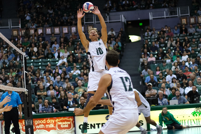 Hawaii setter Jakob Thelle (10) jump sets as middle Guilherme Voss (12) and opposite Rado Parapunov run their routes in an opening night match against Charleston at the Stan Sheriff Center in Honolulu, Hawaii on January 3, 2020.