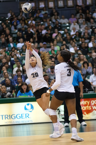 McKenna Ross (20) of Hawaii makes a play for the ball as Amber Igiede (3) watches in the championship match against UCLA in the Outrigger Hotels and Resorts Volleyball Challenge at the Stan Sheriff Center, Honolulu, Hawaii on September 14, 2019.