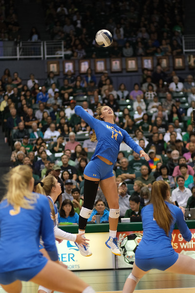 UCLA outside hitter Mac May reaches for a spike in the championship match against Hawaii in the Outrigger Hotels and Resorts Volleyball Challenge at the Stan Sheriff Center, Honolulu, Hawaii on September 14 2019.