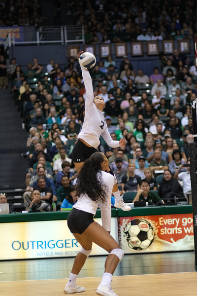 Hawaii hitter Brooke Van Sickle takes a swing as Skyler Williams covers in the championship match against UCLA in the Outrigger Hotels and Resorts Volleyball Challenge at the Stan Sheriff Center, Honolulu, Hawaii on September 14, 2019.
