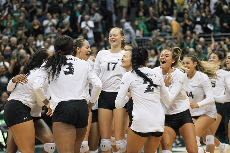 The Hawaii team gathers at midcourt to celebrate after winning the championship match against UCLA at the Outrigger Hotels and Resorts Volleyball Challenge on September 14, 2019, at the Stan Sheriff Center in Honolulu, Hawaii.