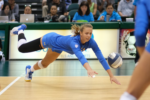UCLA outside hitter Mac May dives for the ball in the championship match against Hawaii in the Outrigger Hotels and Resorts Volleyball Challenge at the Stan Sheriff Center, Honolulu, Hawaii on September 14 2019.