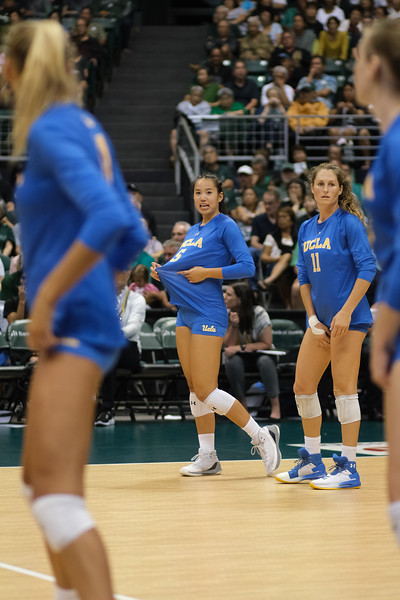 UCLA setter Devon Chang signals the play before serve receive in the championship match against Hawaii in the Outrigger Hotels and Resorts Volleyball Challenge at the Stan Sheriff Center, Honolulu, Hawaii on September 14, 2019.