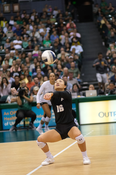 Hawaii libero Rika Okino bump sets across the court to hitter Brooke Van Sickle in the championship match against UCLA in the Outrigger Hotels and Resorts Volleyball Challenge at the Stan Sheriff Center, Honolulu, Hawaii on September 14, 2019.