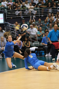 UCLA outside hitter Savvy Simo (11) and setter Devon Chang (5) dive for the ball in the championship match against Hawaii in the Outrigger Hotels and Resorts Volleyball Challenge at the Stan Sheriff Center, Honolulu, Hawaii on September 14 2019.