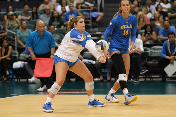 UCLA libero Kelli Barry receives a serve in the championship match against Hawaii in the Outrigger Hotels and Resorts Volleyball Challenge at the Stan Sheriff Center, Honolulu, Hawaii on September 14, 2019.