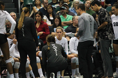 Hawaii's Riley Wagoner listens to coach Angelica Ljungvist during a timeout in the championship match against UCLA in the Outrigger Hotels and Resorts Volleyball Challenge at the Stan Sheriff Center, Honolulu, Hawaii on September 14, 2019.