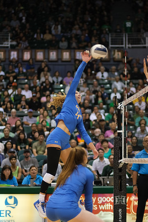 UCLA outside hitter Mac May attacks the ball in the championship match against Hawaii in the Outrigger Hotels and Resorts Volleyball Challenge at the Stan Sheriff Center, Honolulu, Hawaii on September 14 2019.