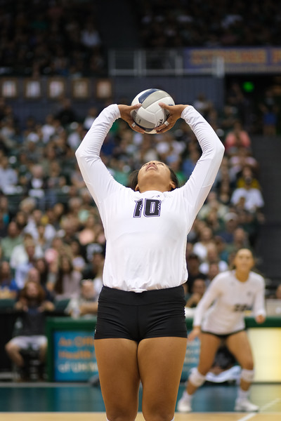 Setter Norene Iosia (10) back sets across the court to hitter McKenna Ross (20) in the championship match against UCLA in the Outrigger Hotels and Resorts Volleyball Challenge at the Stan Sheriff Center, Honolulu, Hawaii on September 14, 2019.