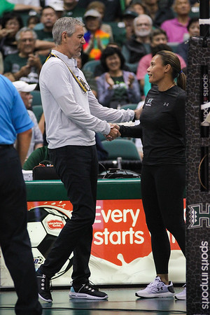 UCLA head coach Mike Sealy and Hawaii head coach Robyn Ah Mow share a pregame handshake before the championship of the Outrigger Hotels and Resorts Volleyball Challenge at the Stan Sheriff Center, Honolulu, Hawaii on September 14 2019.