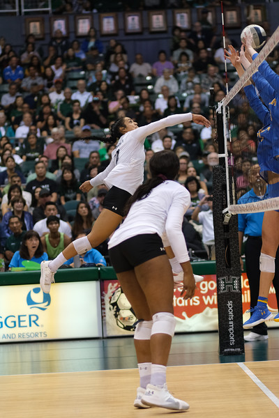 Hawaii outside hitter Brooke Van Sickle pushes the ball off the UCLA block in the championship match of the Outrigger Hotels and Resorts Volleyball Challenge at the Stan Sheriff Center, Honolulu, Hawaii on September 14, 2019.