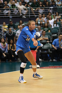 UCLA outside hitter Mac May receives serve in the championship match against Hawaii in the Outrigger Hotels and Resorts Volleyball Challenge at the Stan Sheriff Center, Honolulu, Hawaii on September 14 2019.