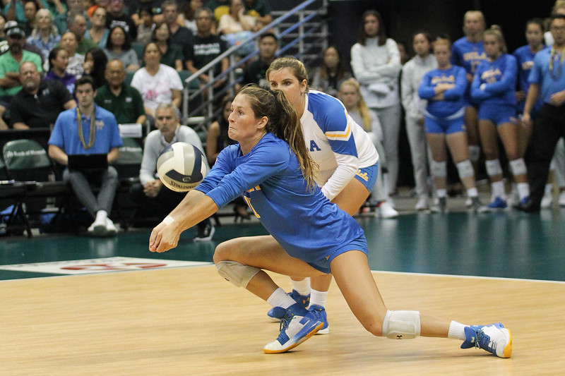 UCLA hitter Savvy Simo gets low to pass in the championship match against Hawaii in the Outrigger Hotels and Resorts Volleyball Challenge at the Stan Sheriff Center, Honolulu, Hawaii on September 14, 2019.
