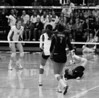 Stanford's libero Gabi Ailes tries mental levitation to keep the ball from hitting the floor