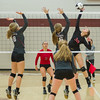 Lady Berries Lauren Shilts (30) slams the ball toward Lady Warriors  Jillian Brumm (8) and Kaitlyn Malchow (6) in volleyball action at Winamac on Thursday night. Fran Ruchalski | Pharos-Tribune