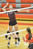 Crofton's Maria Wortmann goes up for a spike against Hartington CC Monday night in Norfolk during Conference Volleyball. <br /> Photo by Aaron Beckman
