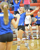Wayne's Tarah Stegemann celebrates the winning point in the third set against Norfolk Catholic Monday night in Norfolk during Conference Volleyball. Wayne beat the Lady Knights in four sets. <br /> Photo by Aaron Beckman