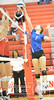 Wayne's Emma Evetovich blocks a ball against Norfolk Catholic Monday night during Conference Volleyball. Wayne beat Catholic in four sets.<br /> Photo by Aaron Beckman