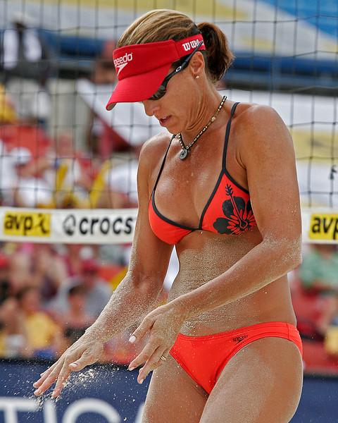 Holly McPeak brushing away sand