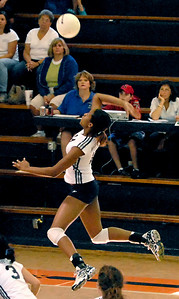 Marietta's outside hitter Telia McCall (14) gains some height as she prepares for a hit against Etowah High School.
