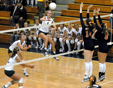 Kennesaw Mountain's Lauren Hutchinson (1) goes for the kill against North Cobb High School Saturday morning.