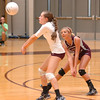 #5, Katelyn Fleming, of D-B cuts in front of teammate, #2, Lexi Hartsock, to return serve. Photo by Ned Jilton II