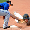 "Warriors Levin Ensign (8) applies to pickoff tag too late against Evan Kerr in the game against Canon City played at Centaurus High School in Lafayette on July 24, 2012.<br /> For more photos go to  <a href=""http://www.bocopreps.com"">http://www.bocopreps.com</a>.<br /> Photo by Paul Aiken / The Camera"