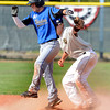 "Warriors Greg Przedpelski (2) stands up after a slide as Logan Nethercot applies the tag too late on Przedpelski's double in the game against Canon City played at Centaurus High School in Lafayette on July 24, 2012.<br /> For more photos go to  <a href=""http://www.bocopreps.com"">http://www.bocopreps.com</a>.<br /> Photo by Paul Aiken / The Camera"