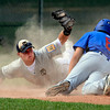 "The Warriors David Shald (6) dives back safely to third base as <br /> Brandon Rix (20) tries to apply the tag in the game against Canon City played at Centaurus High School in Lafayette on July 24, 2012.<br /> For more photos go to  <a href=""http://www.bocopreps.com"">http://www.bocopreps.com</a>.<br /> Photo by Paul Aiken / The Camera"