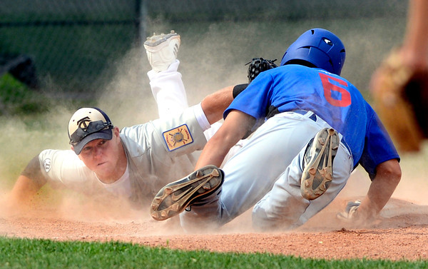 "The Warriors David Shald (6) dives back safely to third base as <br /> Brandon Rix tries to apply the tag in the game against Canon City played at Centaurus High School in Lafayette on July 24, 2012.<br /> For more photos go to  <a href=""http://www.bocopreps.com"">http://www.bocopreps.com</a>.<br /> Photo by Paul Aiken / The Camera"