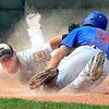 """The Warriors David Shald (6) dives back safely to third base as <br /> Brandon Rix tries to apply the tag in the game against Canon City played at Centaurus High School in Lafayette on July 24, 2012.<br /> For more photos go to  <a href=""""http://www.bocopreps.com"""">http://www.bocopreps.com</a>.<br /> Photo by Paul Aiken / The Camera"""