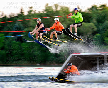 Shockwaves jumpers, left to right, Donny McGinty, Patrick Fitzgibbons, Charlie Woodson, and going underneath all the action, Tim Fitzgibbons gives the spectators at Parker Lake Park a real show stopper Wednesday, Aug. 10, in Plymouth.