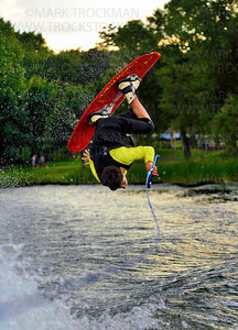 Shockwaves skier Adam Gerkin gets inverted on his Wakeboard for the crowd gathered Wednesday, Aug. 08, at Parkers Lake Park.