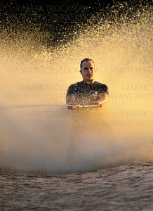 Shockwaves 16-year member Tim Fitzgibbons  barefooting in the Gang Foot maneuver Wednesday, Aug. 10, at Parkers Lake Park in the evening golden light.