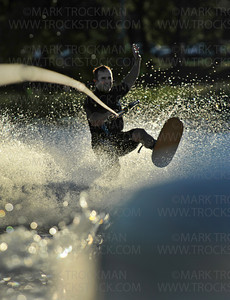 The Shakopee-Prior Lake Shockwaves Water Ski Team's Tim Fitzgibbons using shoe-skis during his act Wednesday, Aug. 11, 2010, on Parkers Lake in Plymouth.  Tim has been on the team for 16 years.  His wife runs the sound table and three of his children are active skiers on the team.