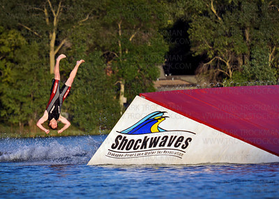 "Tyler Pickney caught in the air during his planned ""bail-out"" of his skis off the jump during The Shakopee-Prior Lake Shockwaves Water Ski Team's performance for hundreds of audience members at Parkers Lake Park in Plymouth wednesday, Aug. 11, 2010."