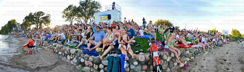 A panoramic photograph of the hundreds of audience members at Parkers Lake Park during The Shakopee-Prior Lake Shockwaves Water Ski Team's performance on a hot Wednesday evening, Aug. 11, 2010, in Plymouth.