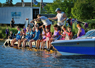 A little chaos on the dock before the start of the girls pyramid.  The Shakopee-Prior Lake Shockwaves Water Ski Team Show director Jared Hollister is organizing and gathering all the ropes for the 12 athletes in the upcoming performance on Parkers Lake in Plymouth Wednesday, Aug. 11, 2010.