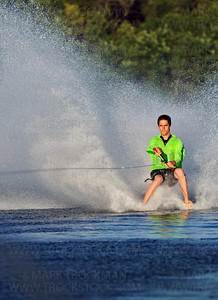 Shockwaves Water Ski Team member Charlie Woodson, uses the experience from his eight years on the team for a barefooting exhibition on Parkers Lake during the team's performance in Plymouth Wednesday, Aug. 11, 2010.