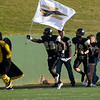 Bushland's Michael Matthews (22) leads the Falcons onto the field.