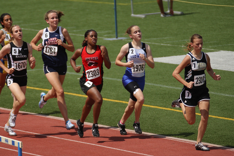 Brooke Selby (Rider) leads the pack in the 800m relay. Danielle Randolph is close behind. Selby finished 4th (2:31.80) in the heat and Randolph finished 3rd (2:25.78), advancing to the finals of the Region 1-4A track meet.