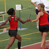 Marniqua Thompson passes the baton to Kaitlin Foran as the WFHS Lady Coyotes advance to the finals of the 4X400m relay by finishing with a time of 4:03.97.  Also on the relay team were Sierra Anderson and Chloe Thornton.
