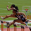Porshia Forbes (Odessa Permian) and Irielle Dunbar (Haltom) race in the 6th heat of the Div 2 100 meter hurdles.